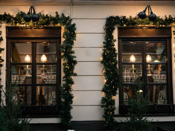 stylish luxury  christmas  vintage garland on window, celebration decoration for holidays in the city