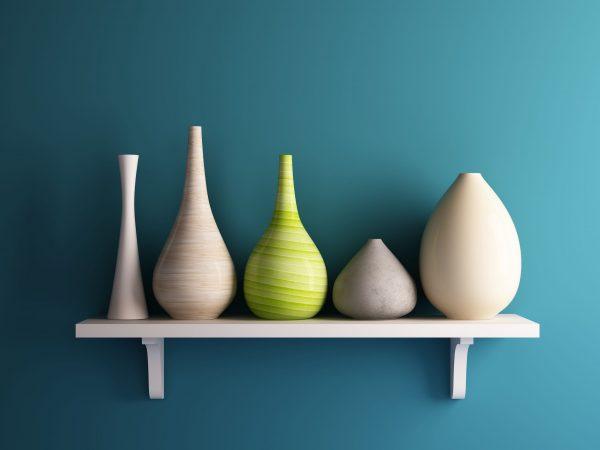 vase on white shelf with blue wall