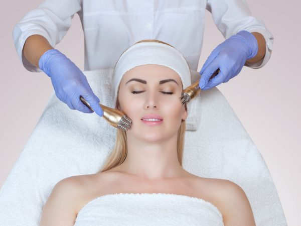 Portrait of woman getting rf-lifting. Rf lifting procedure in a beauty parlour