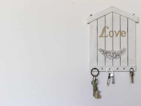 Decorations and objects for interiors. A keychain in the shape of a house as a concept of love and family.