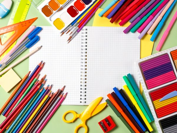 Back to school concept. School supplies on a pastel background, copy space