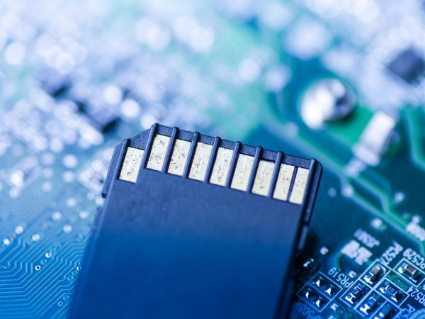 SD Card with mainboard technical background close up